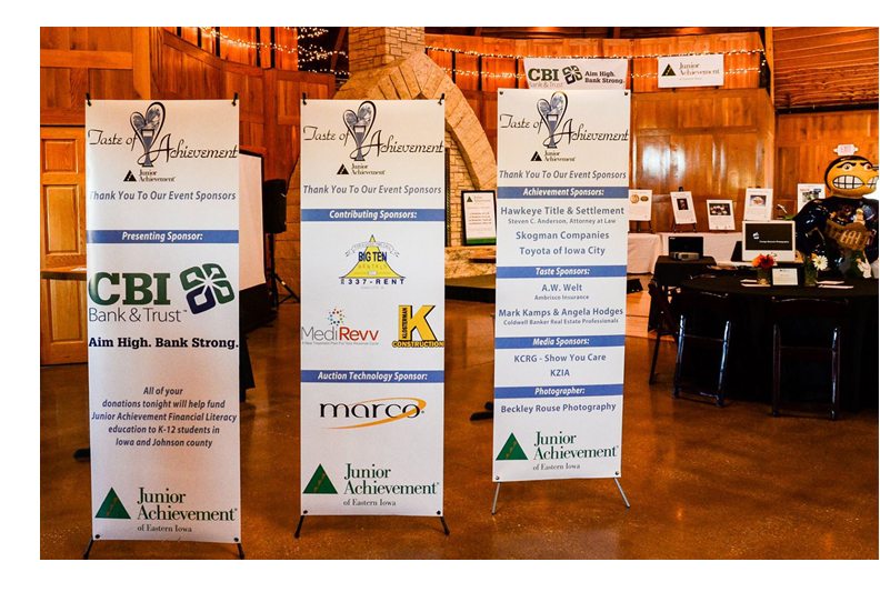 Photo of display at a Junior Achievement Fundraising Event with signage indicating CBI Bank and Trust is Primary Sponsor